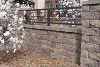 Finished Wall with Ornamental Fence Above
